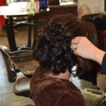Brunette getting hair curled