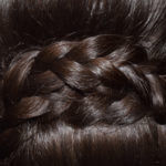 Dark hair braid close up