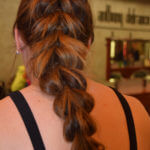Long braid on bare back